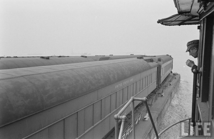 "A railroad captain overlooks mortuary cars loaded on Bush Terminal Carfloats, taken from the wheelhouse of ""Eleanor Bush,"" November 1947. Photo: Life Magazine Archives. Provided by TrainWeb.com. Used by permission."