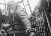 Flying Officer checks settings on control panel on an Avro Lancaster B Mark III